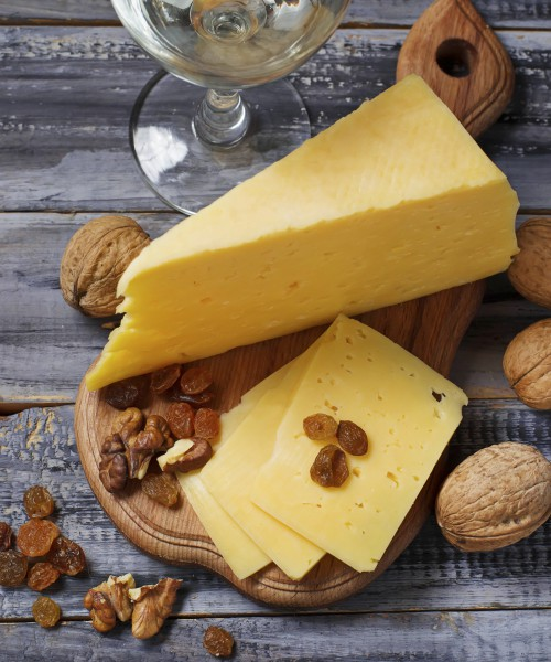 Cheese with nuts and raisins. Selective focus